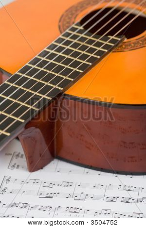 Acoustic Guitar And Sheet Music, Macro Shot