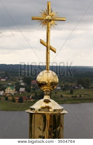Gold Cross With Belltower'S Reflection