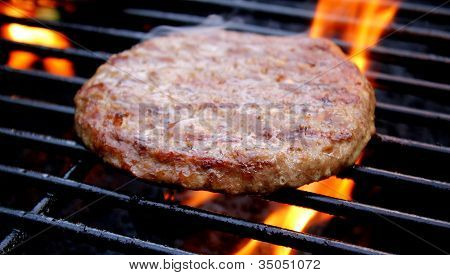 Juicy Burger Cooking On The Grill