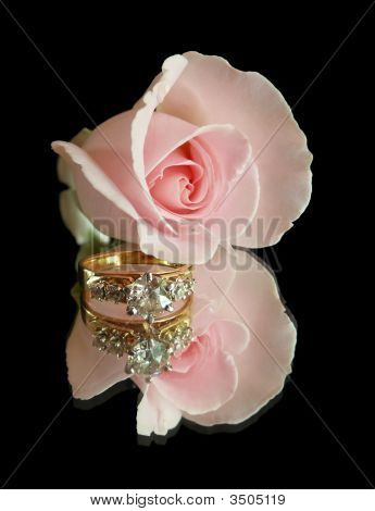 Engagement Ring And Pink Rose On Black