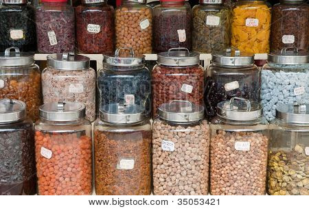 nuts beans and dried fruit in jars for sale