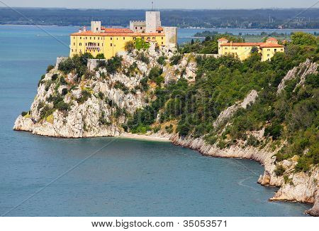 Gothic Duino castle on a cliff over the Gulf of Trieste (Adriatic sea), Italy. The castle dates back to 1389.