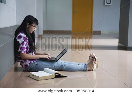 College Student In Campus Aisle