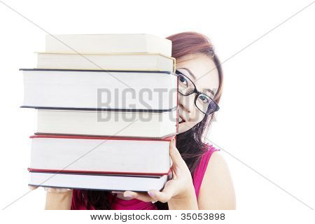 College Student Smiling Behind Books