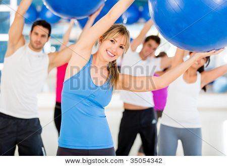Group of people doing Pilates with a Swiss ball