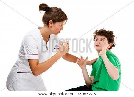 Nurse giving young boy injection isolated on white background