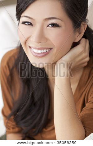 Close up portrait of a beautiful happy young Chinese Asian Oriental woman or girl