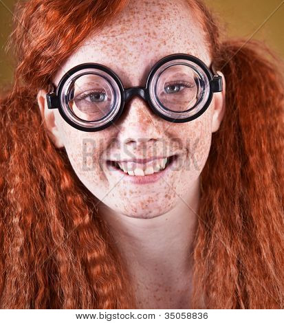 Cheerful freckled nerdy girl