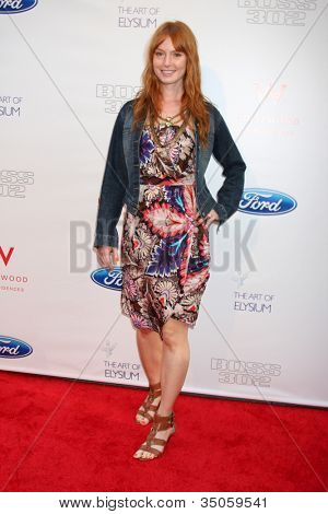 LOS ANGELES - JUN 9:  Alicia Witt arriving at the Art of Elysium Return of Ford Mustang Boss Event at The Residences at W Hollywood on June 9, 2011 in Los Angeles, CA