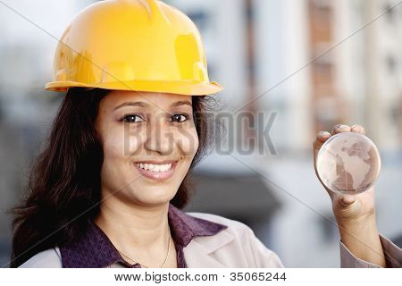 Construction Female Engineer Holding A Globe