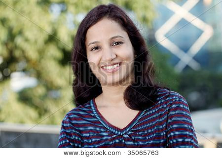 Smiling Teen Girl In College Campus