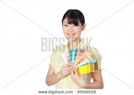 Happy young woman  showing color chart isolated on white background.