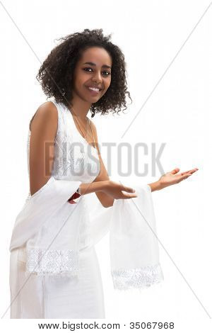 Isolated image of a young Ethiopian woman making a welcome gesture in her traditional dress