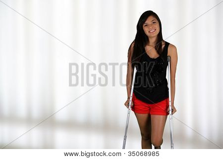 Girl standing on crutches in the hospital