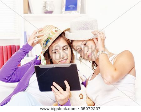 Happy Teenage Girls Having Fun Using Touchpad Computer