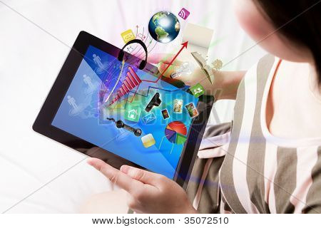 Woman reading the touch screen device (Elements of this image furnished by NASA)