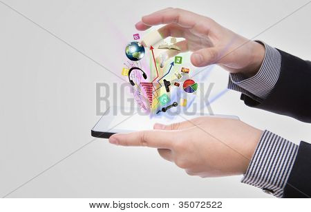 Business man using a touch screen device against white background (Elements of this image furnished by NASA)