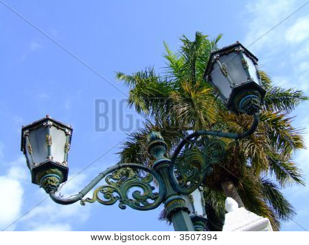 Dutch Colonial Street Lamp Against Palm Tree In Yogyakarta, Indonesia