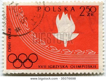 POLAND - CIRCA 1960: A post stamp printed in Poland shows a torch, devoted to 17th Olympic Games - Rome, series, circa 1960