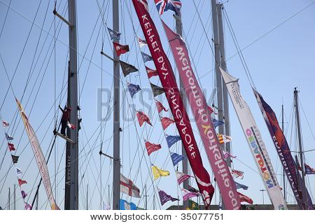 OCEAN VILLAGE, SOUTHAMPTON UK - JULY 22: Clipper Round the World Yacht Race. Detail of the flags and banners as the yachts arrive in Southampton. 22 July 2012