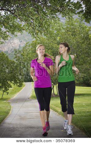 Beautiful Female runners on a path