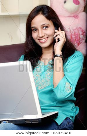 Young Woman Talking On Cellphone