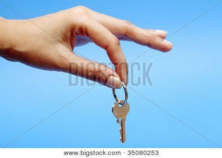 Key In Hand On Blue