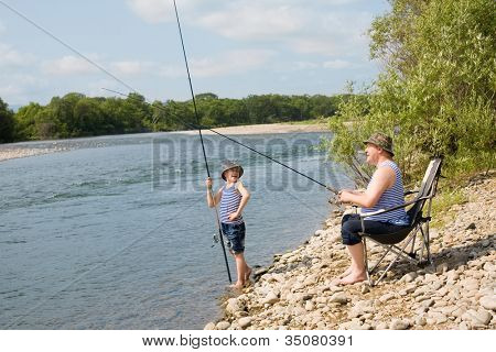Grandfather and grandson go fishing on weekend.
