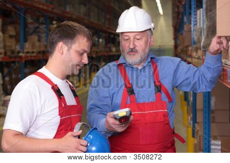 Two Workers In Factory