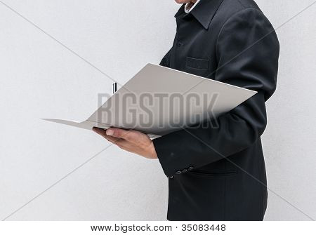 Business Man Writing A Note At Work