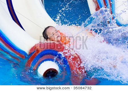 Little Girl On A Water Slide