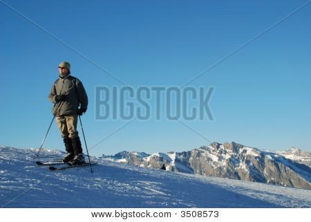 Alpine Skier Looking On The Alps From Mountain Top