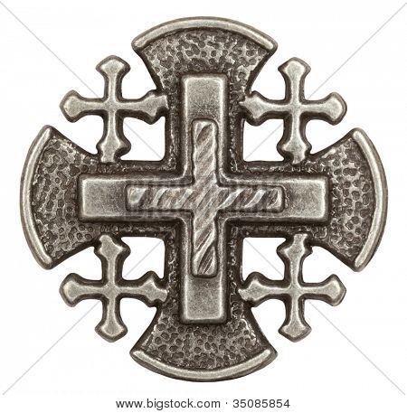 Silver Jerusalem cross with religious inscriptions in white background Super macro