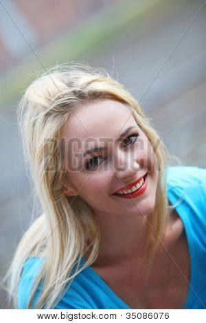 Portrait Of A Smiling Blonde Woman