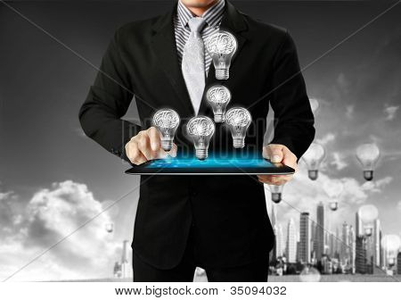 touch-tablet in hands with businessman
