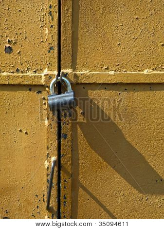Iron access lock on brown antique door