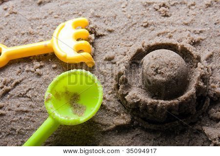 Plastic sandbox child toy on summer beach sand