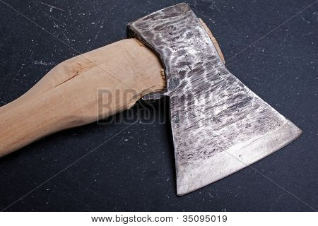 Sharp metal hatchet or axe wood cutting work tool