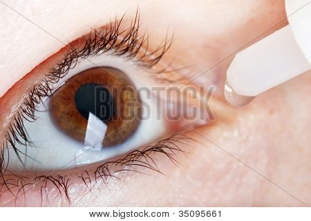 Medicine healthcare liquid eyedropper on human eye