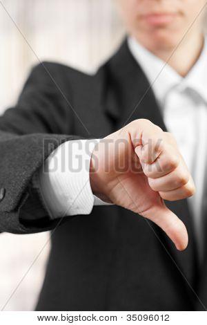 Business women hand gesture thumb down failure sign