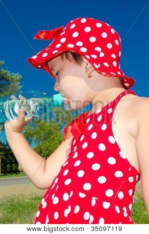 A Little Girl Drinks Water
