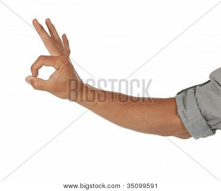 Arm with hand showing ok sign