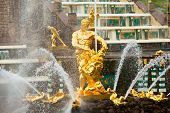 stock photo of samson  - Famous Samson and Lion fountain in Peterhof Grand Cascade in St - JPG