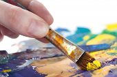 stock photo of verbs  - Somebody is painting some picture with paintbrush - JPG