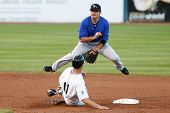 CENTRAL ISLIP-JULY 21: Long Island Ducks infielder Shawn Williams (11) is forced out by Sugar Land S