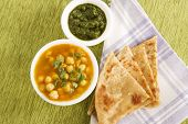 stock photo of garam masala  - Chana masala with Paratha Indian Food on green mat - JPG