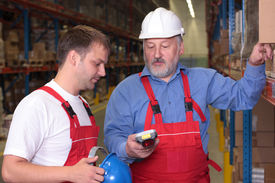 picture of older men  - A view of a senior engineer training a newly hired employee - JPG