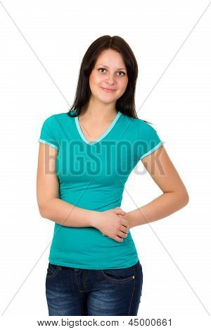 Young Woman In Green T-shirt And Blue Jeans Posing Over White