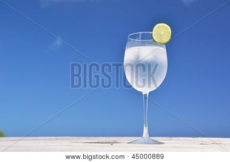 Glass of water against blue sky