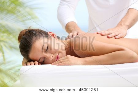 Brunette girl receiving a massage